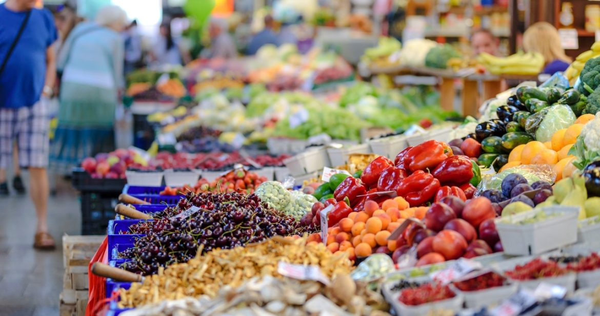 A store filled with lots of fresh produce Description automatically generated